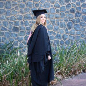 Girl in UNE Graduation Gown
