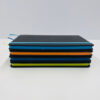 UNE Merch, black cover coloured edge notebook, University of New England