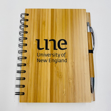 UNE Merch, Wooden cover notebook with pen, University of New England