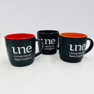 UNE Merch, black coffee cup coloured inside, University of New England