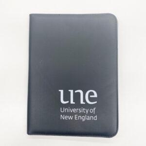 UNE Merch, Black Compendium, University of New England