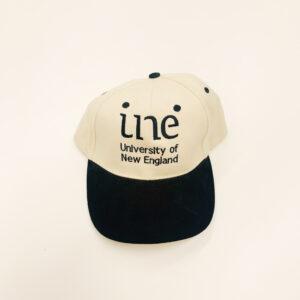 UNE Merch, Black and Cream Cap, University of New England